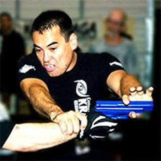 """James is the #1 Best Selling Author of the book on Amazon """"How to be a Super Hero: How to Recognize, Avoid, and Survive Violent Encounters, Assault, and Getting Shot in an Active Shooting. He holds 2nd Dan and 3rd Dan Black Belt Ranks with several Krav Maga organizations as well as among the first to receive the """"Krav Maga Senior Instructor"""" certification from Wingate in Israel. Wingate Institute is the Israeli National Center for sports and athletics and houses the Israeli school for Coaches. James was in the very first group of instructors to get licensed to teach Krav Maga outside of the National Training Center in LA back in 1997. He earned his Krav Maga Instructors Black Belt in 2003 as only the second to do so in the United States outside of LA and the first ever in Colorado. James is a fully certified Force Training Master Instructor who has taught courses in Fort Hood for the United States Army and is currently teaching Law Enforcement Courses throughout the United States and works as a contract Trainer for the Boulder County Sheriff's Department. James was also on the Krav Maga Worldwide Advisory Board and one of only a handful of Instructors that hold """"Train the Trainer"""" status and who is qualified to train and certify instructors in the highest levels of Krav Maga and has personally certified hundreds of Krav Maga Instructors worldwide. James' background in Martial Arts began at age 9 in Judo, then progressed through the years with Karate, taekwondo, hapkido, and of course now Krav Maga. Outside of Krav Maga, James tries to get as much snowboarding, wakeboarding, ATVing, camping, and golfing in as he can when he's not chilling at home with Shannon and their 4 dogs."""